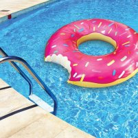 Pool floats like doughnuts, swans, flamingos and unicorns are one of the hottest trends of summer 2016.